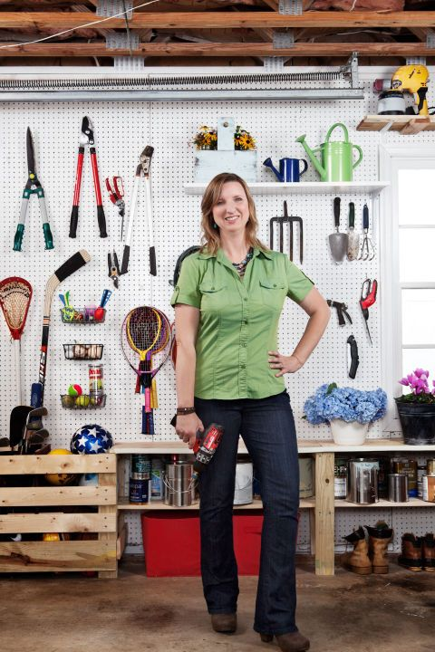"""Handywoman Brittany Bailey, who writes the blogPrettyHandyGirl.com,arranged her tools on pegboard so thatthe most frequently used items are easily accessible:garden tools near the garage entrance (close to the yard), sports equipment farther in where she loads up the car trunk, and tools within arm's reach of her workbench. """"It's so much easier to find something when I need it!"""""""