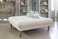 Introducing our Avignon furniture collection.  A comfortable and stylish range modelled on the famous Louis XV period.  Crafted from birch wood with button detail, our ottoman can be used as a footstool or coffee table.  Upholstered in natural linen with castors so it can be moved with ease.  A classic French style furniture piece.  We recommend a stain resistant treatment to protect the fabric, such as Scotchguard.  Also available in black velvet and charcoal grey cotton.  Matching armchair…