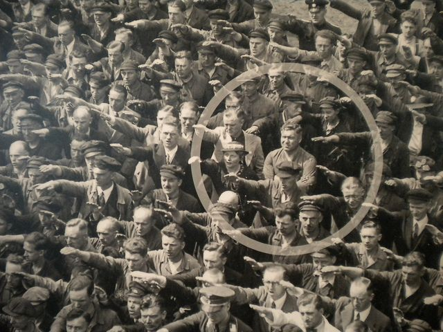 The photo was taken in Hamburg in 1936, during the celebrations for the launch of a ship. In the crowed, one person refuses to raise his arm to give the Nazi salute. The man was August Landmesser. He had already been in trouble with the authorities, having been sentenced to two years hard labour for marrying a Jewish woman.