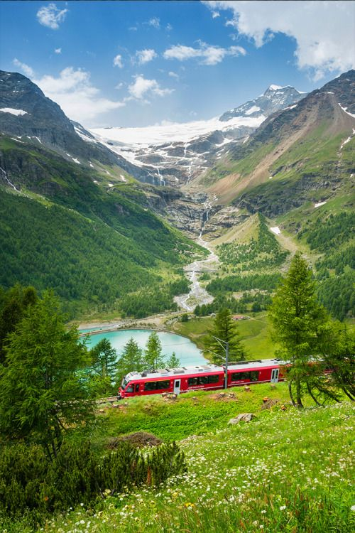 The Bernina Express passes Lago Pallù in the Italian Alps on its journey from Switzerland to the Italian town of Tirano // photo by @justinfoulkes #italy #alps #train