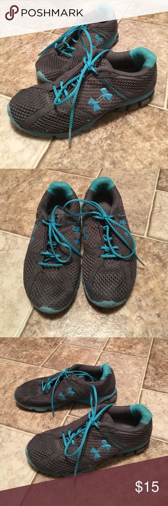 Under Armor tennis shoes Super cute grey and teal Under Armor shoes! Super comfortable!! They are a little worn, but still have PLENTY of go left in them!! Under Armour Shoes Athletic Shoes