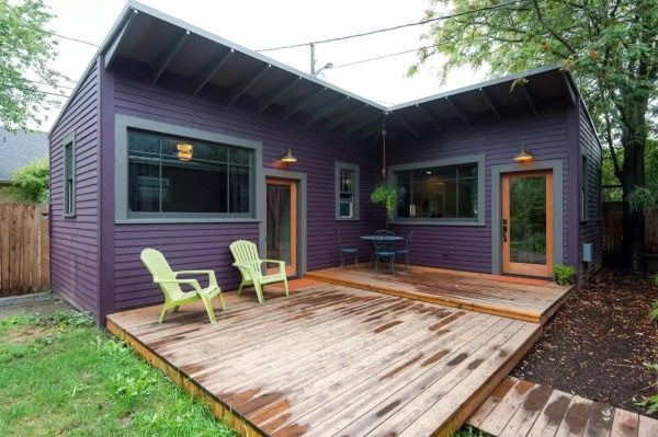 "Small, single-level purple cottage in North Portland is an ""L"" with the kitchen and living room in one leg and a bedroom and bathroom in the other. They enclose a large, accessible deck. It's a simple, uncluttered layout that's easy to get around. 