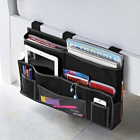 Studio 3B Bedside Storage Caddy In Black If your dorm room that is way too small, the Studio 3B Bedside Storage Caddy will save you some much-needed space at bedside. Its 5 hefty pockets hold heavy books and other bulky items, and its smaller pockets can contain numerous items, as well.