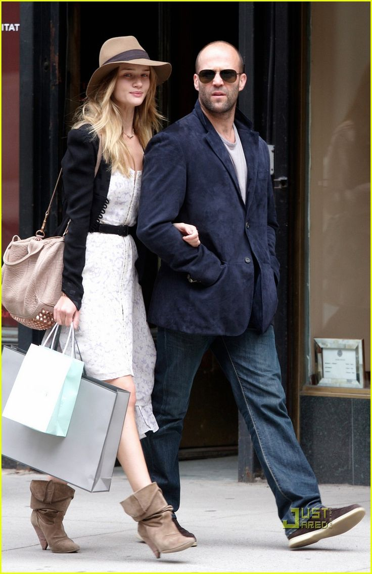 Rosie Huntington-Whiteley: Madison Avenue with Jason Statham! Just look at her smirk! Holding Jason Statham's arm, who wouldn't smirk like that, lol!