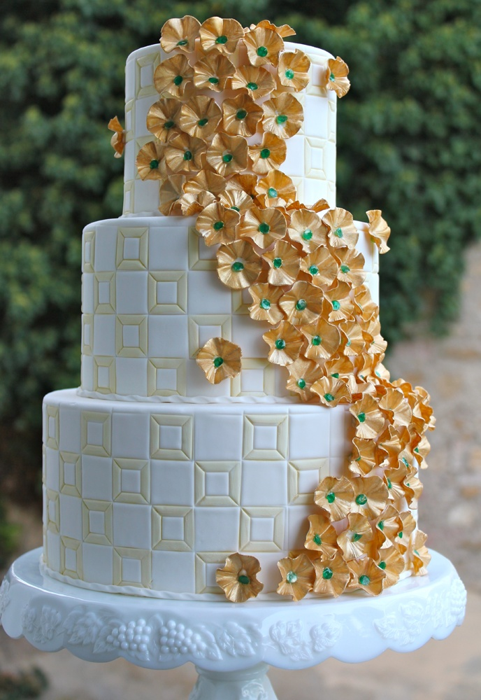 """Perfect Oz cake :-)... faint background to mimic """"yellow brick road""""...poppy flower cascade with emerald centers."""