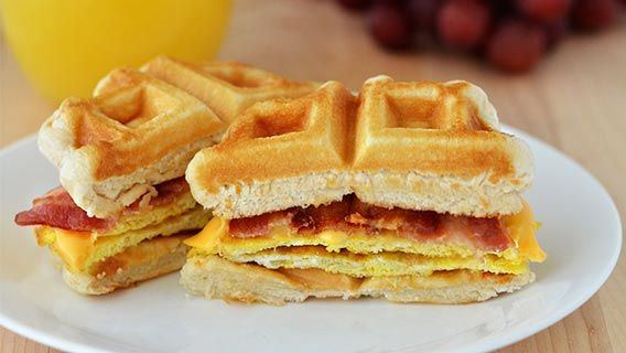Make your waffles to-go. Simply stack with savory bacon, egg, and cheese and you're starting the day the tasty way.