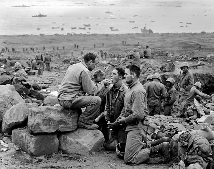 JAPAN. Iwo Jima. February 1945. Marines receive communion.  Photograph: Joe Rosenthal/AP