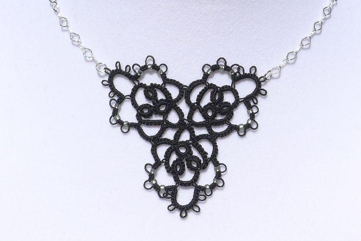 em'u*lous necklace