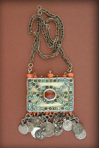 Antique fire-gilt silver necklace-pendant from Khiva ( Khorezem ) in Uzbekistan.   Fire-gilt silver decorated with turquoises, cornelian and coral beads. The dangles are a mix of old islamic and russian coins with others elements.    Very nice workmanship, late 19th century, early 20th century.