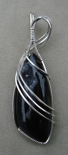Woodward Ranch Agate Wire Wrap.  Elegant wrap where stone is background to featured wrap.