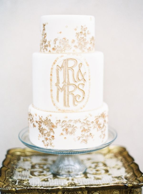 Gold Flaked Wedding Cake | photography by http://marissalambertphotography.com/: Ideas, Cakes Photography, Gold Flakes, Cakes Design, Gold Wedding, Cakes Wedding, White Wedding Cakes, Weddingcak, Gold Monograms