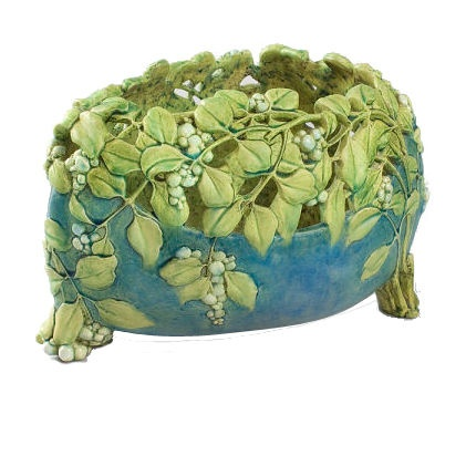 French Art Nouveau Ceramic Earthenware Jardiniere by Lachenal  France  Circa 1900's  A French ceramic earthenware jardiniere by Lachenal, featuring an irregular oval shape with green openwork foliate and berry design over a blue base supported on three branch-form feet, impressed mark.