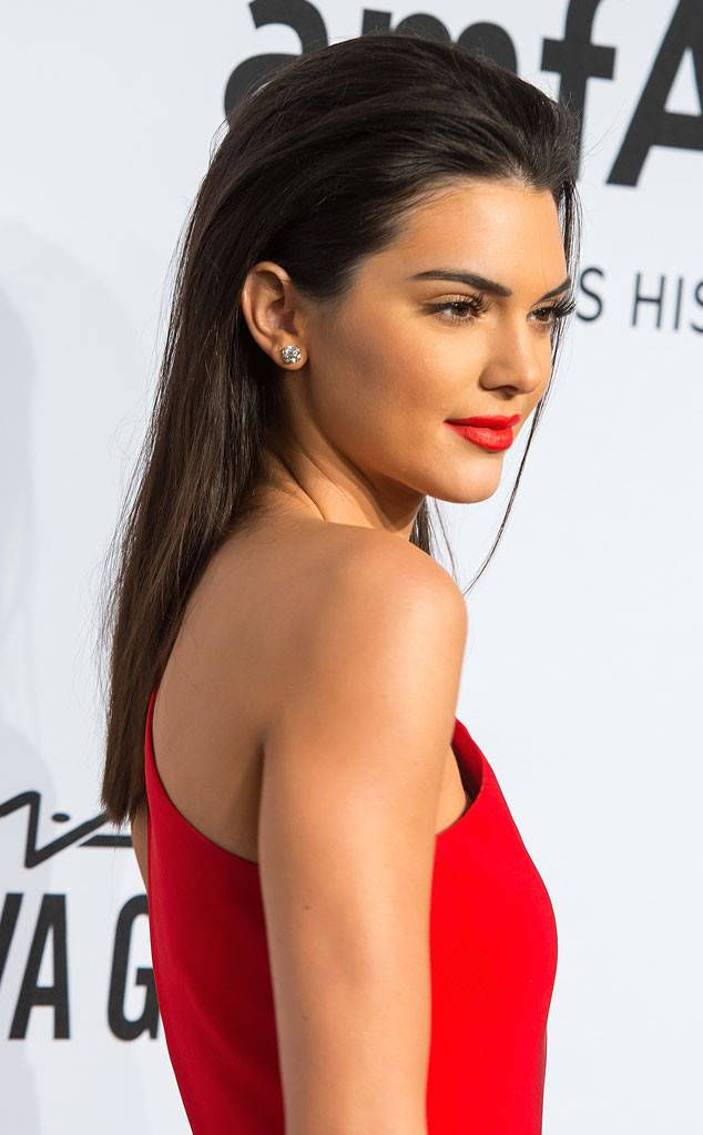 Slicked Back Styles from The Mane Event: Hot Hair Trends  No part, no problem! Kendall Jenner and more stars are obsessed with slicked back hairstyles like this.