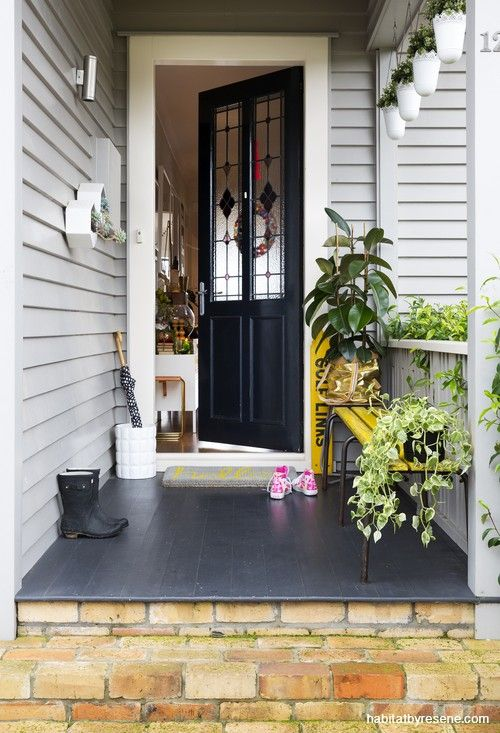 A monotone approach gives a smart result for this bungalow, where the door is in glossy Resene Black, and the weatherboards are Resene Rakaia.