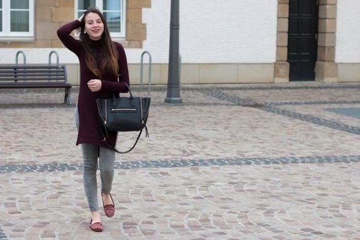 Shop this look on Lookastic:  https://lookastic.com/women/looks/burgundy-sweater-dress-grey-skinny-jeans-burgundy-loafers/14318  — Grey Skinny Jeans  — Black Leather Tote Bag  — Burgundy Sweater Dress  — Burgundy Suede Loafers