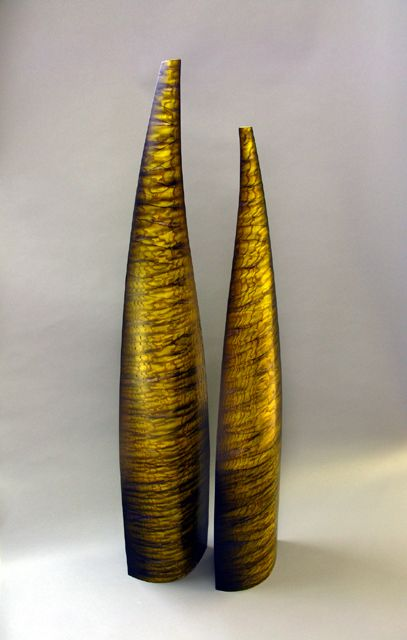"""Floor-Standing Buds in Tamo Ash (Yellow - Green)  Tamo ash, rock maple, dyes, resin  54"""" x 12"""" x 6"""" / 48"""" x 12"""" x 6""""    Majestic and electrifying, the cascading shimmer of the Tamo Ash flame shines through the delicate veil of criss-crossing color."""