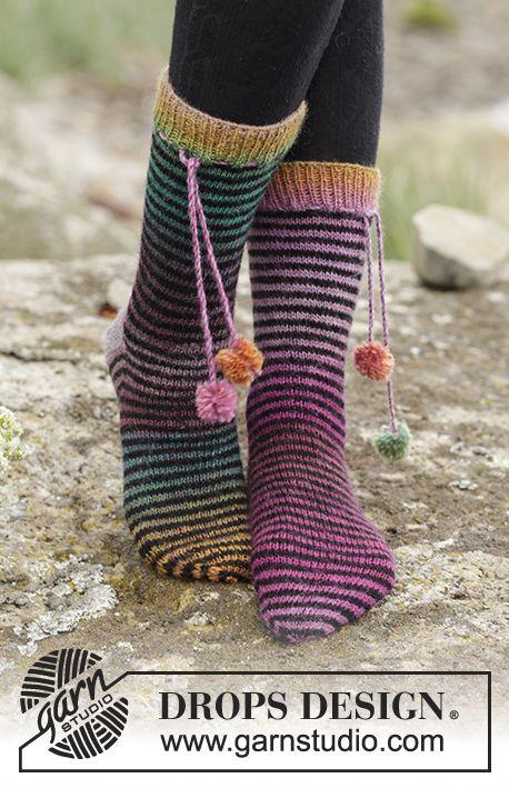 Tivoli socks with stripes by DROPS Design. Free #knitting pattern