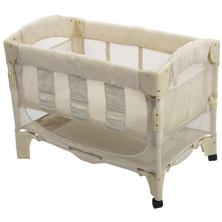 The Arm's Reach Mini Arc Euro Co-Sleeper bedside bassinet is a unique creation that allows you and your baby to sleep comfortably next to each other from the moment the baby arrives. The Co-Sleeper position enables you to reach over and draw your baby close for comforting and bonding. The innovative design also makes breastfeeding easy. The Mini Arc Euro Co-Sleeper bassinet is the sleep solution for any concerned parent.<br><br>The Mini Arc Euro Co-Sleeper bassinet has two modes, the…