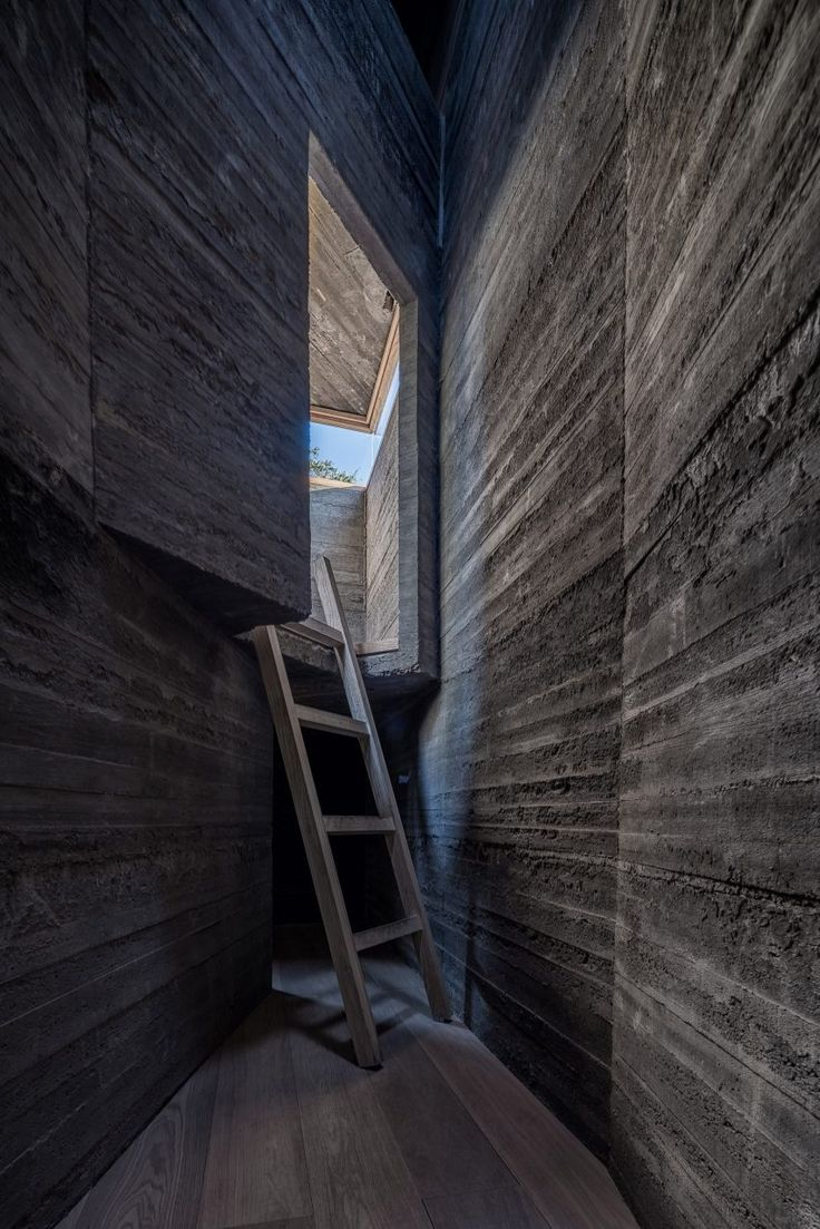 Micro-Hutong hostel by ZAO/standardarchitecture is constructed from concrete mixed with Chinese ink.