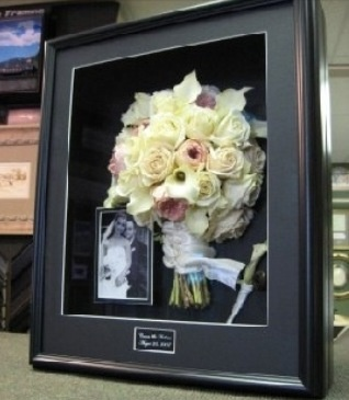 Freeze dry your boquet and place in a shadow box. :)