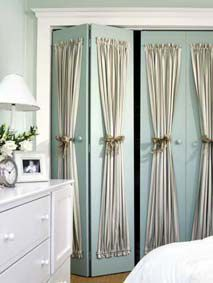 dress up boring closet doors using rods and gathered window treatments