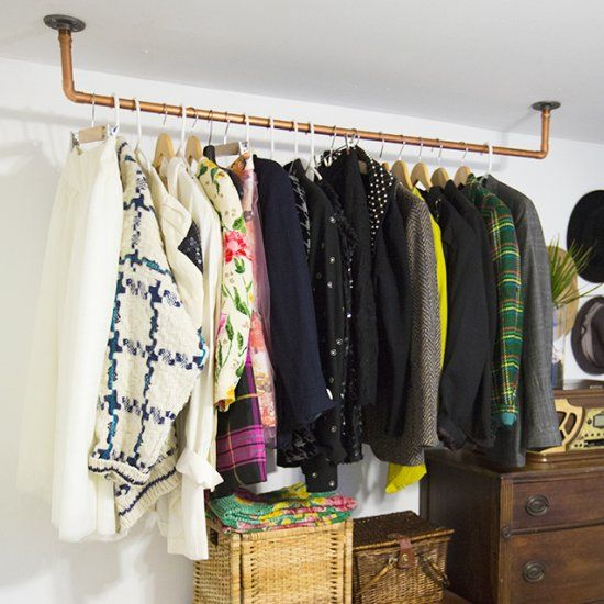 Hanging copper pipe clothing rack craft gawker extra for What to do with extra clothes hangers