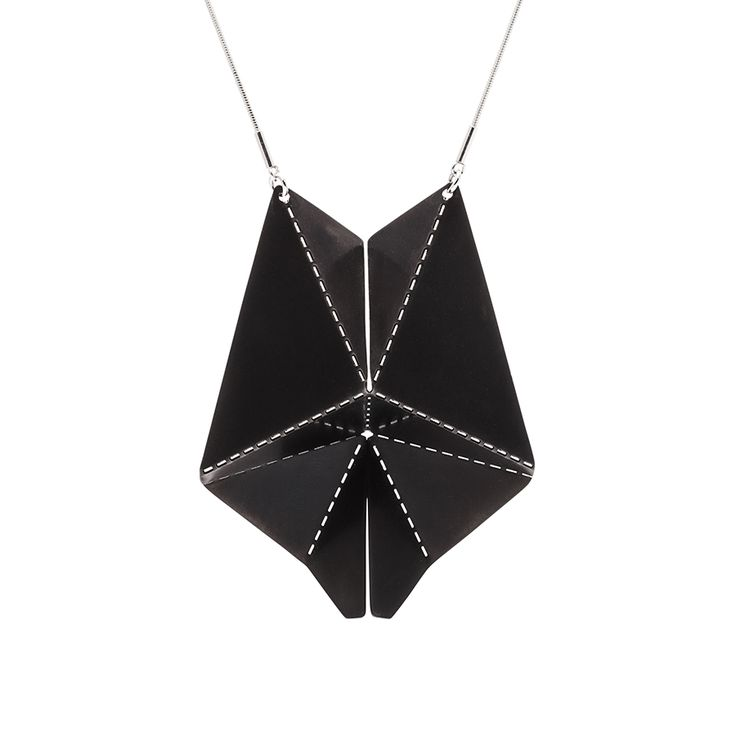 Handmade necklace of black stainless steel, hanging on metal chain.