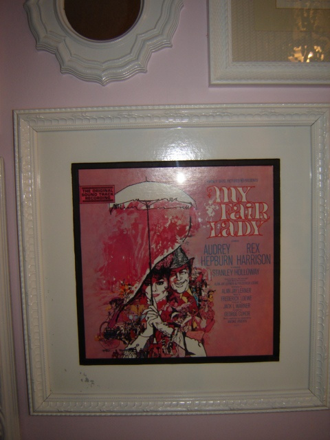 I have 2 My Fair Lady framed pictures...well, they are actually vinyl album artwork. I just cut off the cover and framed it. It goes so well with my room and the Audrey Hepburn quote and book.  Such a simple way to create fun and cool artwork for a room.