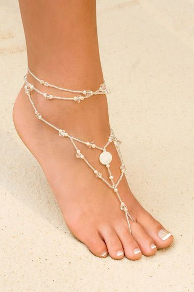 foot jewelry for the bridesmaids and bride to go along with the beach theme.