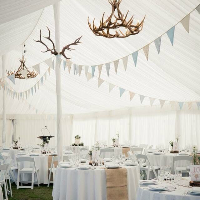 Marquee Wedding, bunting is a great way to decorate that elegant high pitched roof.