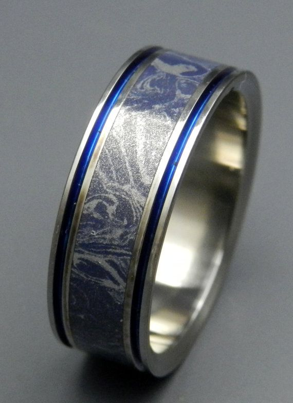 Ancient art meets modern marvel. Featuring Blue Bronze Silver metalstock styled in the Mokume Gane tradition of Japan, this band is a modern