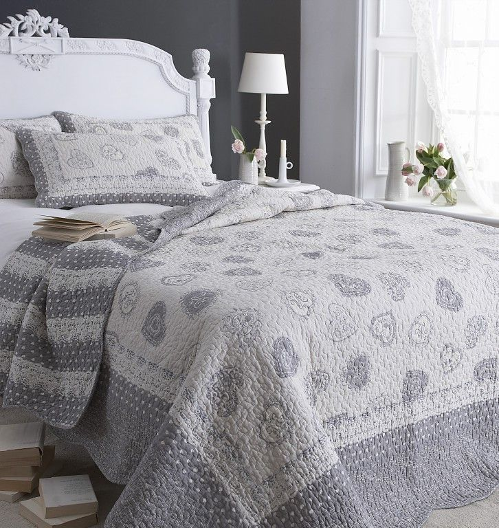 Stunning grey quilted bed throw with hearts King size £110 buy from https://lachatelaine.eu/collections/throws-bedspreads/products/lucerne