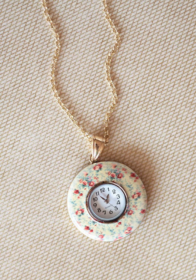 """Floral Meeting Clock Necklace 19.99 at shopruche.com. Effortlessly beautiful, this gold tone necklace holds a floral pendant with a functional clock.29"""" long, Pendant: 1.75"""" diameter: Shopruch Com, Floral Clocks, Style, Meeting Clocks, Ruched Clocks, Floral Meeting, Accessories, Vintage Necklaces, Clocks Necklaces"""