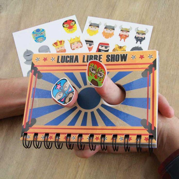 Luchador duimgevecht notitieboek en stickers  Description: Duimgevecht boek en stickers. Boekje met zes verschillende scènes voor een duimgevecht. Voor een duimgevecht op het werk of op school. Ruzie met collega? Gooi al je frustraties eruit tijdens het duimworstelen. Inclusief 32 karakters in stickersvorm van o.a. Mexicaanse worstelaars en vickings. Kies een achtergrond uit steek je duim door het gat en plaats een sticker op je duim. Geschikt voor kinderen van 10 jaar en ouder.  Price: 2.98…