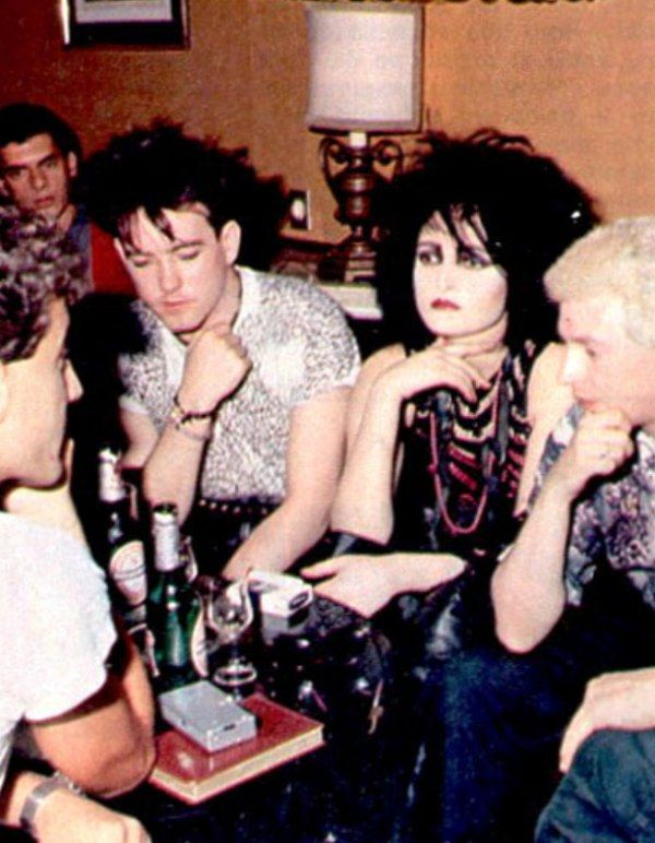 Siouxsie And The Banshees with Robert Smith of The Cure on Siouxsie's right.