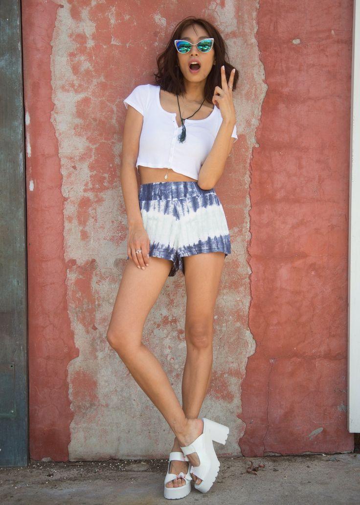 Ana Kim wearing ZERO UV Sunglasses, BuddhaWear shorts, and Miista shoes