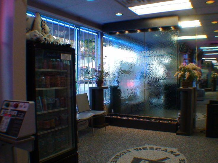 Retail glass water wall fountain indoor. Custom water wall. custom waterfall. http://waterfallnow.com https://waterfalldecor.com