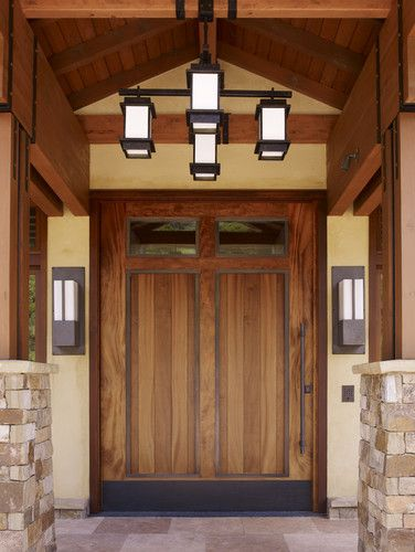 Craftsman style front entry. The lighting is a great proportion to the wide front door.