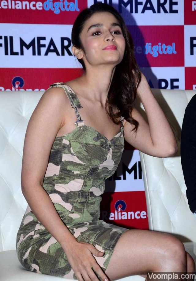 Temperatures rose as Alia Bhatt showed off her toned legs while working a short military print Diesel dress - styled by Ami Patel. via Voompla.com