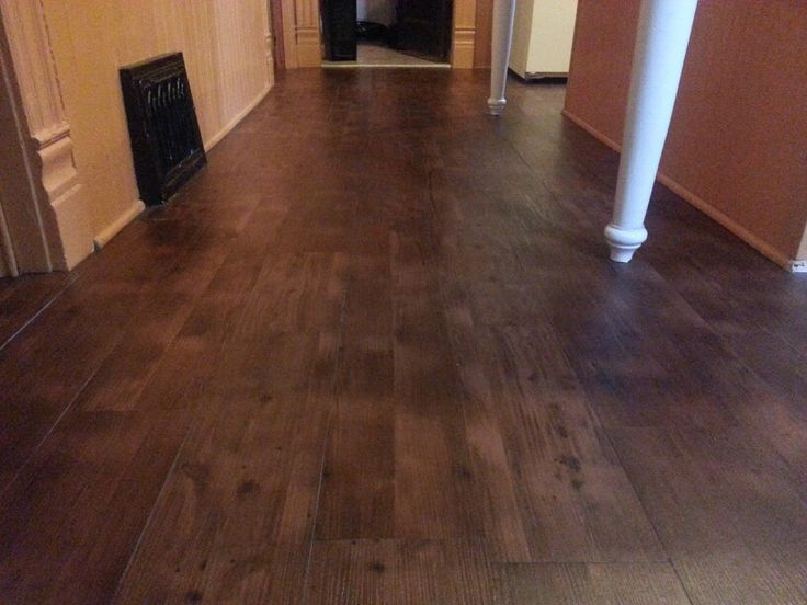 Peel and stick vinyl plank flooring. $.69 per square foot on sale at Lumber Liquidators. Turned out great like real wood. Looks way better with Mop & Glo because planks were matte finished.