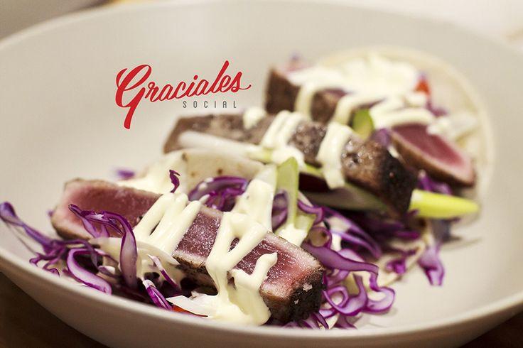 Freshly seared tuna tacos with avocado, lemon, garlic, spring onion and chili. Topped with wasabi mayo at Peddlars & Co.