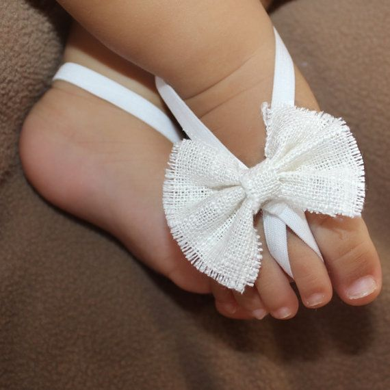 White Bow Sandals, Barefoot Sandals, Baby Barefoot, Baby Sandals, Baby Crib Shoes, Sandals For Babies, Wedding Sandals.  These Startling White Bow Baby Barefoot Sandals are just perfect for any age!  The front part of this sandal will not stretch, but there is enough stretch elastic on the back for a perfect fit. All my products are designed to make your baby look beautiful while feeling really comfortable. Perfect for photo shoots and to wear to a special occasion.  Get a 10% OFF coupon…