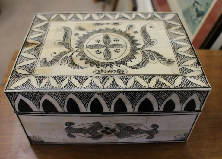 Decorated ivorine jewellery box lined with velvet. Box has hinged lid. Slight wearing to the design to the right hand side as shown in photograph. Size measures 8.5 inches in length, 4.5 inches high and 6 inches wide.