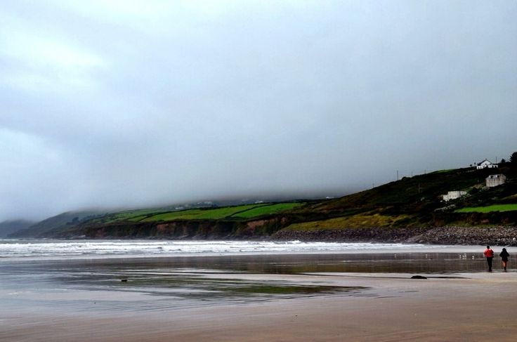 Walking On A Foggy Beach In Ireland