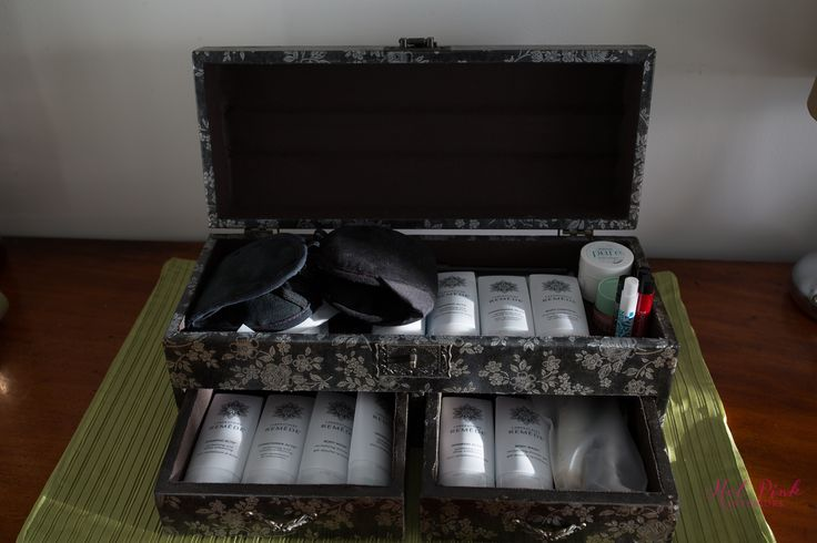 A leather, brown and silver Asian trinket box on the chest of drawers, keeps a variety of toiletries, in case, a guest has forgotten anything.  Shampoo, Conditioner, Bodywash, Face Cream, Razor and Shaving Cream, Toothbrush and Toothpaste and Perfumes are some of items available for guests to use.  Sourced from - @What Nots