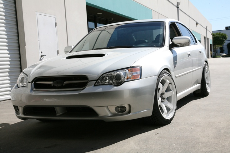 Pearly white Subaru Legacy GT with turbo... not exactly a family car, but so fun to drive!