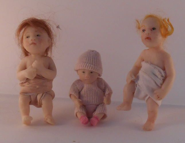 """Catherine Munière - one of a kind hand sculpted children, Baby with brown hair 2 15/16""""tall. Baby with Blonde hair 3""""tall, Baby in knit outfit 2 1/8""""tall; selling on Swan House Miniatures for $550 each"""