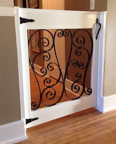 13 DIY Dog Gate Ideas: I need this in my life! Stops the dog from going up stairs, but allows the cat access!