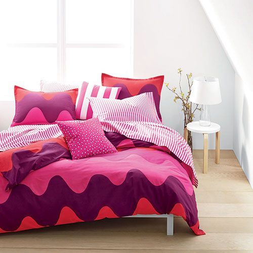 Bedroom turned from drab to fab with these vintage waves colored in punchy variations of pink. Marimekko Lokki Pink Percale Bedding