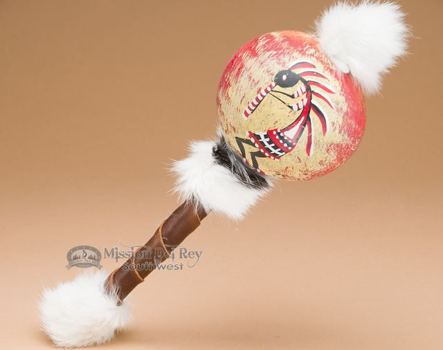 Hand painted Native American style gourd rattle. This gourd shaker is decorated by hand with a painted image from Native American tradition and Indian symbols, feathers and beads. The handle is wrappe